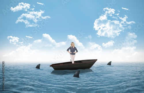 Composite image of thoughtful gorgeous blonde in a sailboat