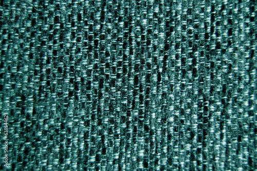 Green fabric wallpaper background close-up