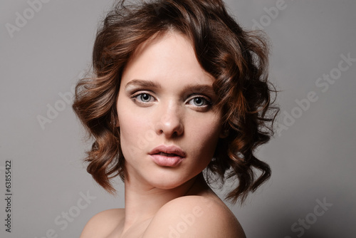 Beauty portrait of beautiful blond girl with professional makeup
