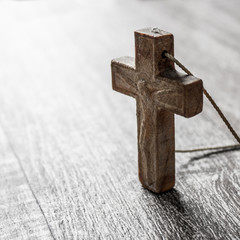 wooden cross on a wooden surface