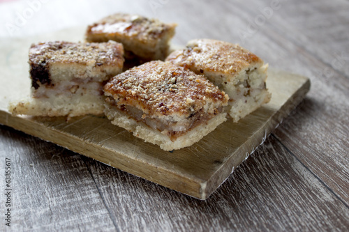 Slices of apple pie on a wooden board