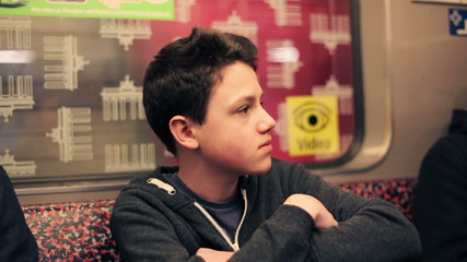 Young teenager riding train, subway