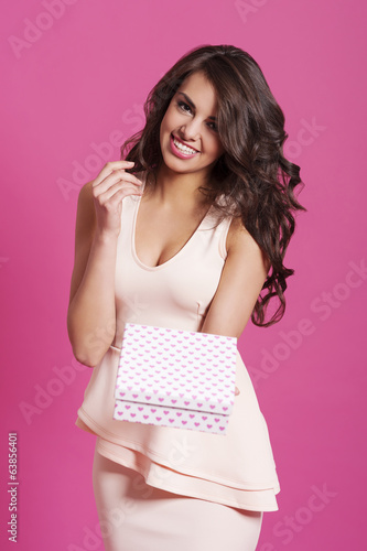 Woman in wavy hair giving small gift box