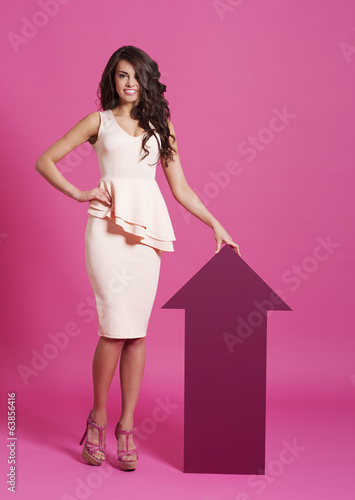 Beautiful fashion woman with moving up arrow