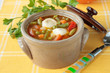 Pot of vegetable soup with dumplings