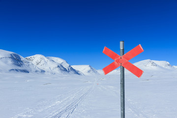 Cross country skiing sign in the snow in Sweden.