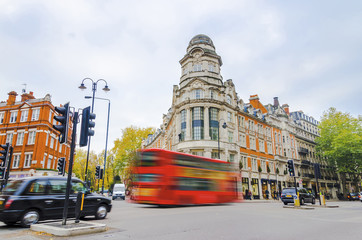 Street with public transportation of double decker bus, London