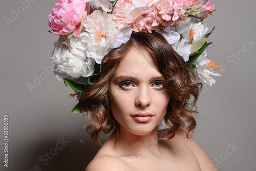 Beauty portrait of a smiling girl with flowers in her hair