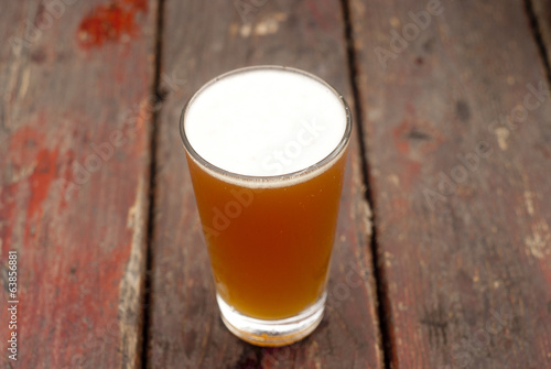 Frosty beer on a wood table