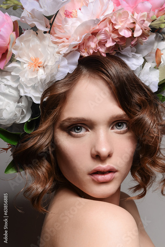 Beauty portrait of a girl with flowers in her hair