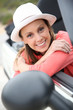 Portrait of smiling girl in convertible car
