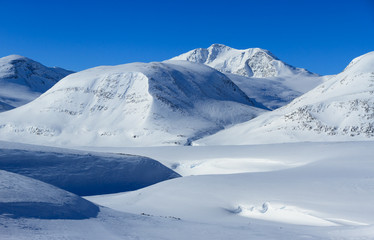 Snow covered mountains in Lapland