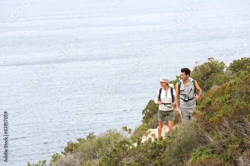 Couple on a hiking day by the sea