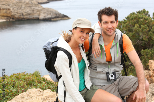 Portrait of smiling couple on a hiking journey