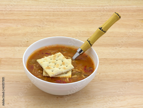 Chicken Sausage Soup With Spoon And Crackers