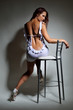canvas print picture - Sexy woman on the high chair