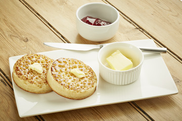 Crumpets toasted on white dish