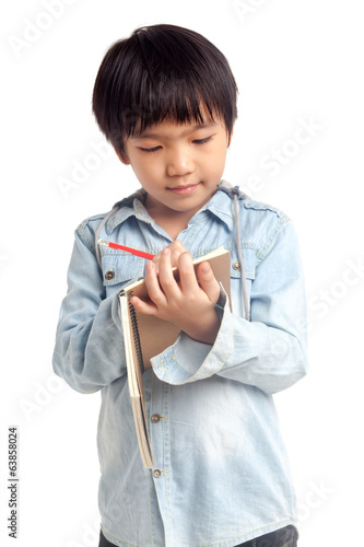 Boy writing on notebook
