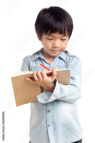 Boy writing with smile