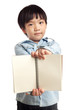Boy holding blank notebook