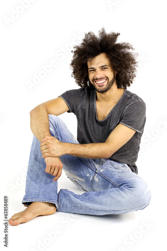 Happy cool man sitting smiling isolated