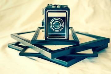 Retro toned vintage box camera and photographs