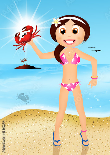 girl with crab on the beach