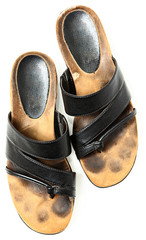 Dirty Old Pair of Leather Sandals Over White High Angle View