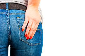 woman's hand with red nails in his pocket jeans