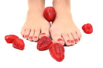 woman feet and strawberries
