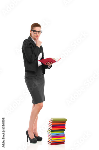 Thinking teacher holding a book