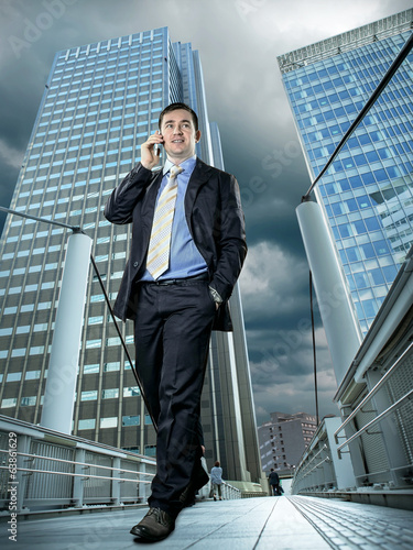 Businessman speaking by phone
