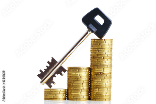 Euro coins and a key, isolated on white