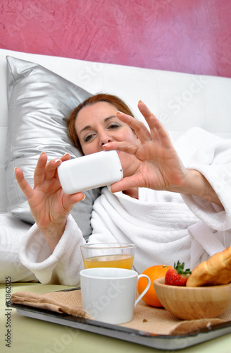 woman breakfast in her bed peacefully