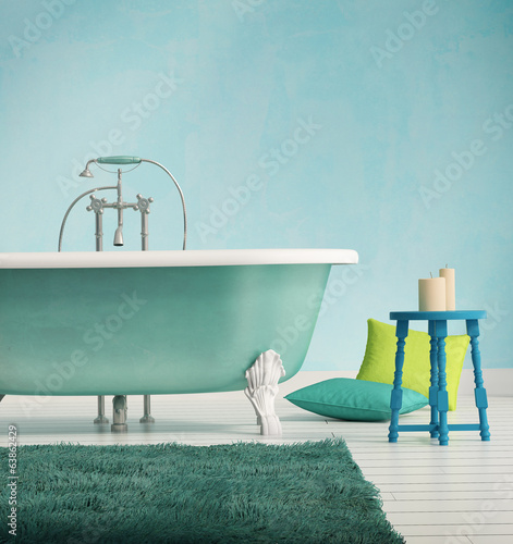 Classic blue bathtub with a stool and aged wood floor
