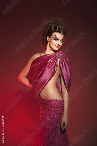 Young beautiful  brunette model in gorgeous dress burgundy color