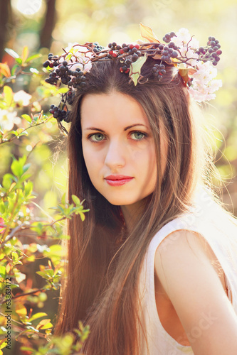 Beautiful woman with flower decoration