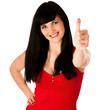 Beautiful young woman gesturing success showing thumb up