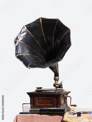 Vintage gramophone with disc on the table