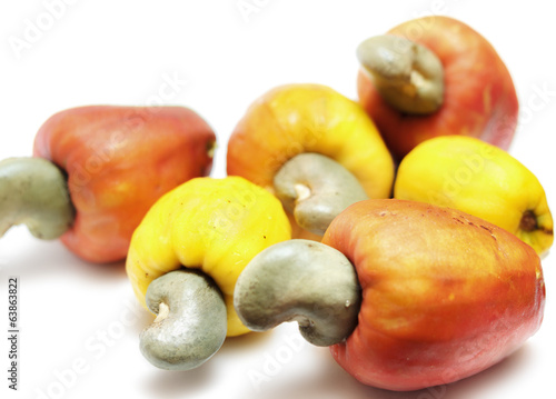 Fresh cashew nuts with apple isolated on white background