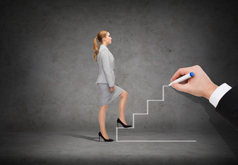 businesswoman stepping up staircase