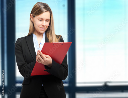 Female manager writing on some documents