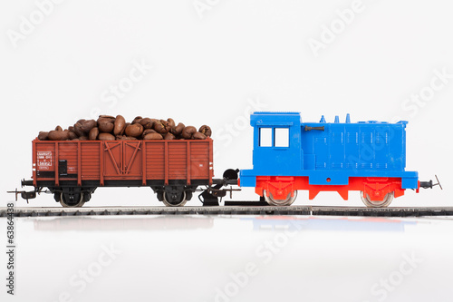 toy train with coffee beans