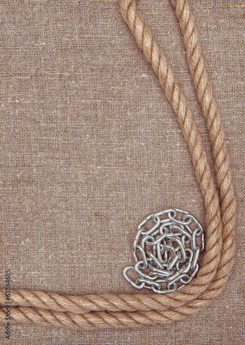 Metal chain and rope on the burlap