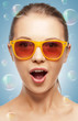 surprised teenage girl in shades
