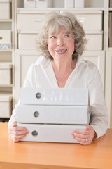 Grey haired woman with files