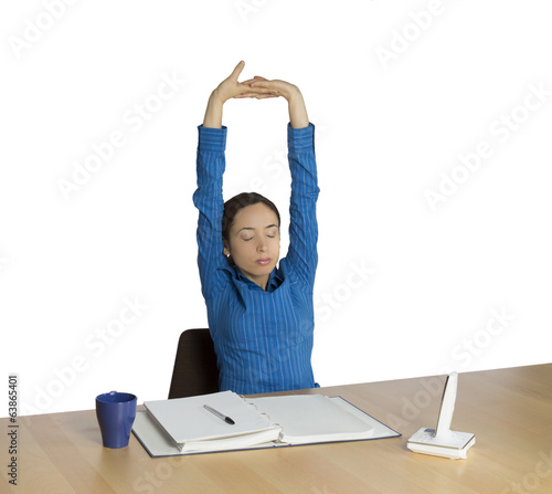 Business woman stretching during work