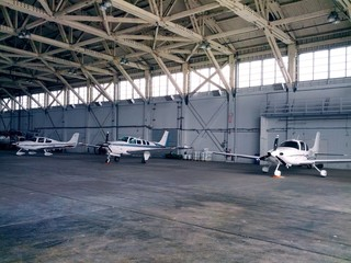 smal business jets parked in the hangar