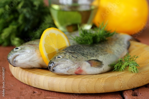 fresh raw trout fish on the kitchen board