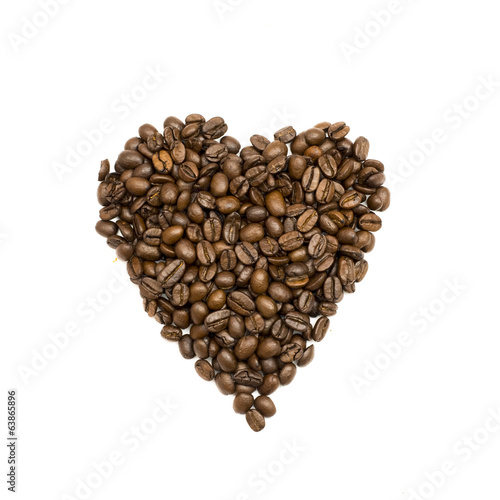 Coffee beans are stacked in the shape of heart